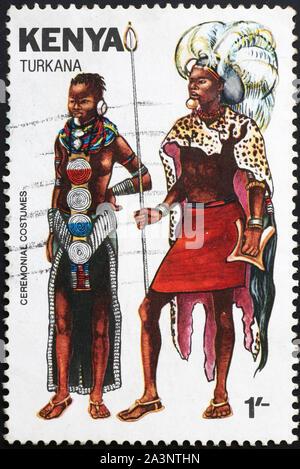 Turkana ceremonial costumes on kenyan postage stamp - Stock Photo