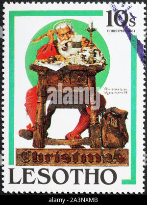 Santa Claus reading letters on stamp, illustration by Norman Rockwell