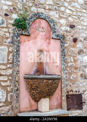 Water fountain in Roussillon, France - Stock Photo
