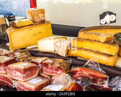 Meats and cheeses on sale at fresh produce market in Provence. - Stock Photo