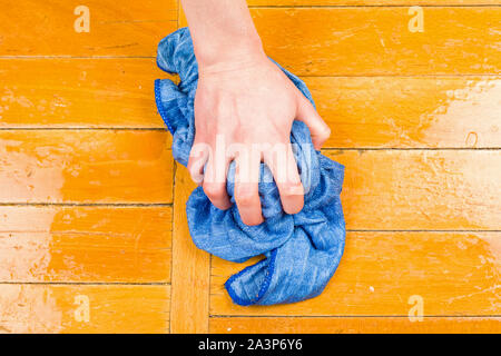 Photo of a hand wash the floor with a rag - Stock Photo