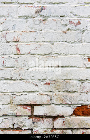 Old wall, cracked and dirty, bricks. White color vertical design background. - Stock Photo
