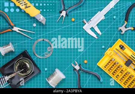 Still life with tools for handmade on the work pad. - Stock Photo