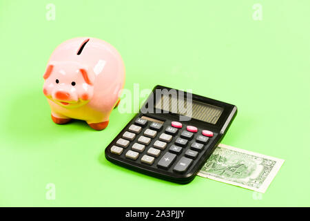 planning and counting budget. moneybox with calculator. Piggy bank. income capital management. bookkeeping. financial problem. money saving. Accounting and payroll. Taking money. - Stock Photo