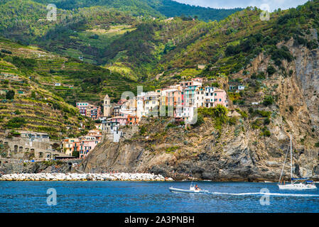 Manarola, Liguria, Italy - August 17, 2019: Picturesque village in the Ligurian province of La Spezia. Colorful houses on the coastal cliffs. Ligurian - Stock Photo
