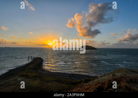 Fiery atmospheric sunrise over the old jetty at Archer Point, near Cooktown, Far North Queensland, FNQ, QLD, Australia - Stock Photo