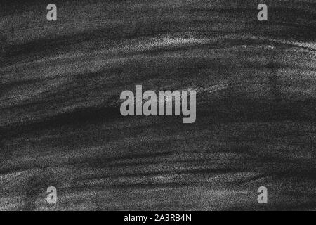 Dirty chalkboard background. Whte chalk stains on blackboard after removing lettering. - Stock Photo