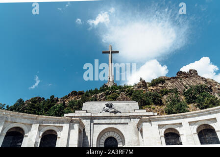 San Lorenzo de El Escorial, Spain - July 7, 2018: View of Valle de los Caidos or Valley of the Fallen. It was erected in the Mountain Range of Guadarr - Stock Photo