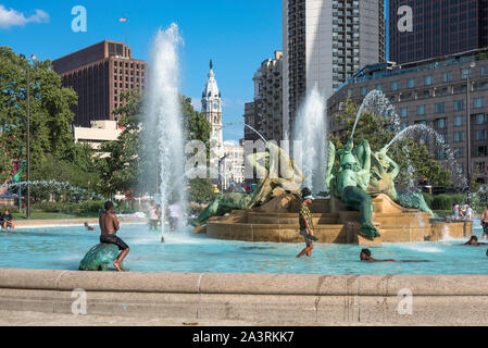 Summer USA city, view of young people playing in the Logan Square fountain on a summer day in central Philadelphia, Pennsylvania, PA, USA. Stock Photo