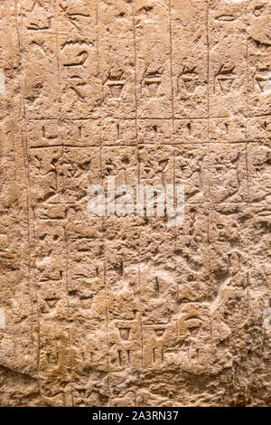 ancient Egyptian stone background wiht inscription in hieroglyphs - Stock Photo