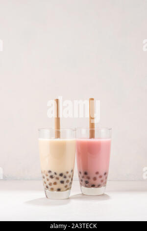 Variety of homemade bubble tea/ boba tea with tapioca pearls on white background - Stock Photo