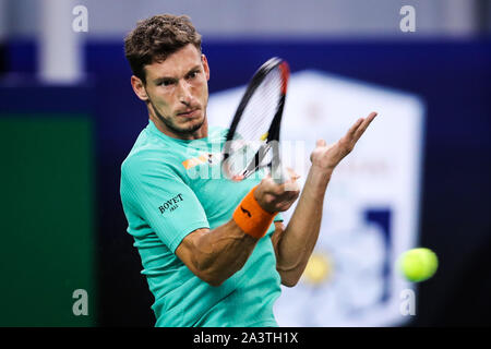 Spanish professional tennis player Pablo Carreno Busta competes against Austrian professional tennis player Dominic Thiem during the second round of 2019 Rolex Shanghai Masters, in Shanghai, China, 9 October 2019. - Stock Photo