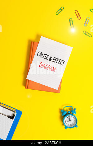 Writing note showing Cause And Effect Diagram. Business concept for Visualization tool to categorize potential causes Paper clips with blank papers fo - Stock Photo