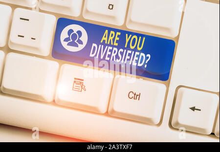 Handwriting text writing Are You Diversified Question. Conceptual photo someone who is Different Mixed Multi Faceted White pc keyboard with empty note - Stock Photo