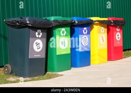 Separate garbage. Waste recycling concept. Containers for metal, glass, paper, organics, plastic for further processing of garbage. Side view - Stock Photo