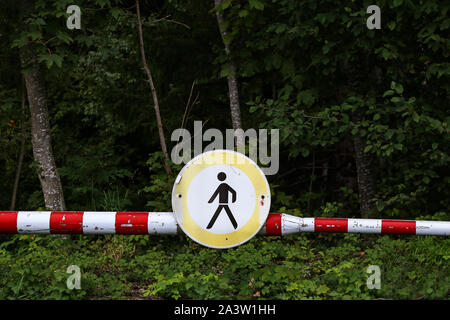 Passage is prohibited - Road sign on the barrier - Stock Photo