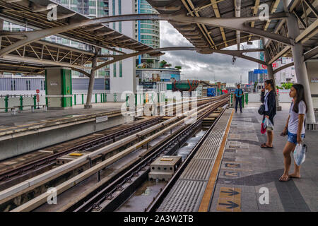 An Ultra-Modern Bangkok Sktrain Station (BTS Skytrain) in Bangkok Thailand. Mass Rapid Transport at its best! - Stock Photo