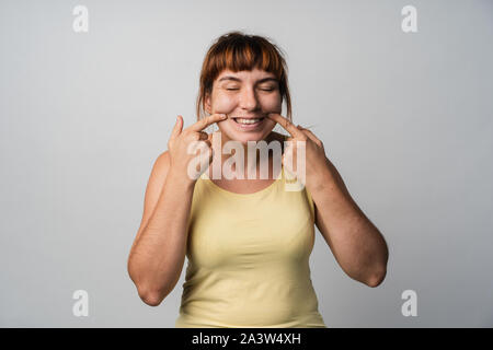 agressive wife look at camera. Studio with white background. - Stock Photo