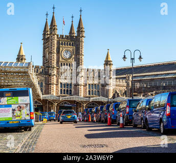 Busy main entrance to Temple Meads station Bristol UK with its gothic facade and clock tower - Stock Photo