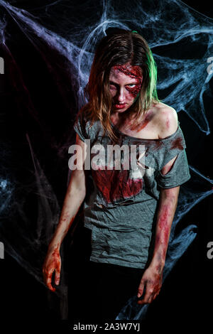 portrait of horrible zombie woman with wounds. Horror. Halloween make-up and costume - Stock Photo