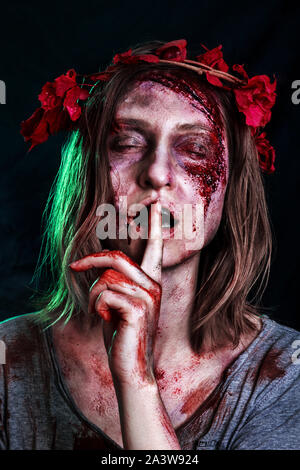 Close-up portrait of horrible zombie woman with wounds. Horror. Halloween poster. The shouting female zombie - Stock Photo