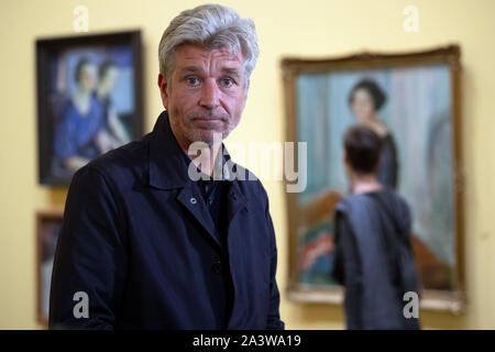 Duesseldorf, Germany. 10th Oct, 2019. Karl Ove Knausgard, bestselling author, is in the Kunstsammlung NRW. Knausgard has created a lavish exhibition of paintings by Edvard Munch. The pictures shown are lesser known, but nevertheless striking, of the famous painter. The exhibition 'Edvard Munch - seen by Karl Ove Knausgard' can be seen in the Kunstsammlung NRW from 12.10.2019 to 1.3.2020. Credit: Federico Gambarini/dpa/Alamy Live News - Stock Photo