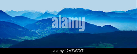 Blue panoramic view of Austrian alps mountains in Soell , Tyrol, Austria - Stock Photo