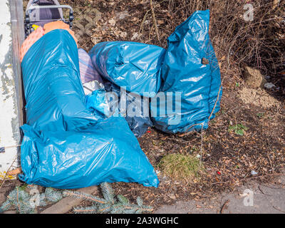 Garbage bags illegally in the forest - Stock Photo
