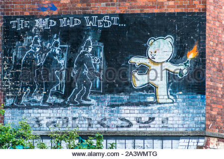 The famous Banksy art work 'The Mild Mild West' at Stokes Croft a colourful district of Bristol full of street art. Avon. England. UK. - Stock Photo