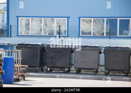 trash bins on the territory of large-scale production - Stock Photo