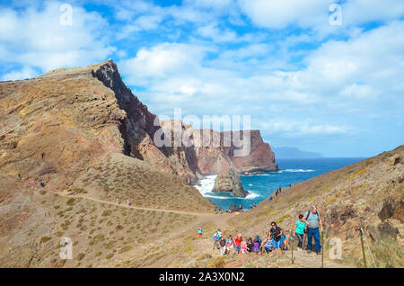 Ponta de Sao Lourenco, Madeira, Portugal - Sep 12 2019: Overcrowded hiking path on trail leading to the cliffs in easternmost point of Madeira Island. Volcanic landscape, Atlantic ocean. mass tourism. - Stock Photo