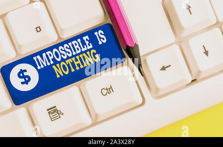 Word writing text Impossible Is Nothing. Business photo showcasing Anything is Possible Believe the Realm of Possibility White pc keyboard with empty - Stock Photo