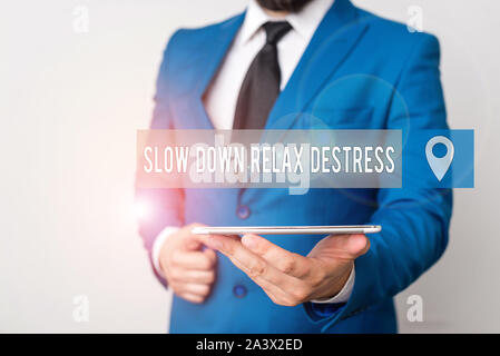 Writing note showing Slow Down Relax Destress. Business concept for calming bring happiness and put you in good mood Businessman in blue suite with a - Stock Photo