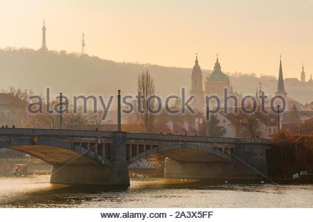 Golden sunset light over Manes bridge in Prague, Czechia - Stock Photo