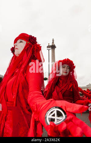 Extinction Rebellion climate protestors continued their occupation of Trafalgar Square for a fourth day, with some super-gluing their hands to the road to block traffic. Police used a JCB with a cherry-picker to remove activists from a wooden tower which had been placed in the middle of a road.