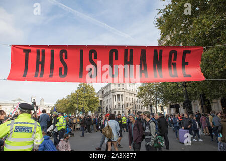 Westminster, London, UK. 10 October 2019. Environmental campaigners Extinction Rebellion have started two weeks protests from 7th to 20th October in and around London to demonstrate against climate change. The protesters in Trafalgar Square demand decisive action from the UK Government on the global environmental crisis. - Stock Photo