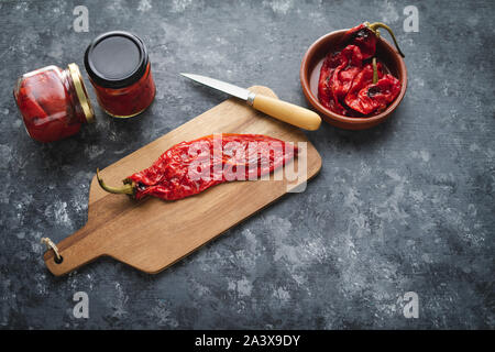 Preparing roasted red peppers for packaging.