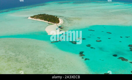 Tropical island among coral reefs with a white beach and blue atoll water. Onok Island, Balabac, Philippines. Summer and travel vacation concept - Stock Photo