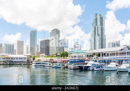 Miami, USA - September 11, 2019: View of the Marina in Miami Bayside with modern buildings and skyline in the background. - Stock Photo