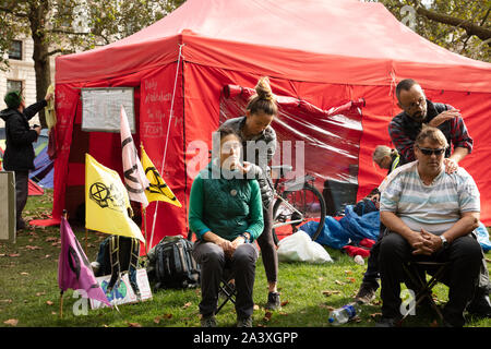 London, UK. 9th October 2019. Protesters receiving massage in St James's Park, Westminster, during the Extinction Rebellion two week long protest in London. Credit: Joe Kuis / Alamy News - Stock Photo