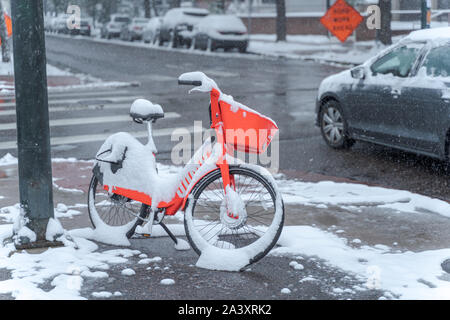 Denver, Colorado, USA- October 10, 2019: e-bicycle during Denver's first snow storm of the season. - Stock Photo