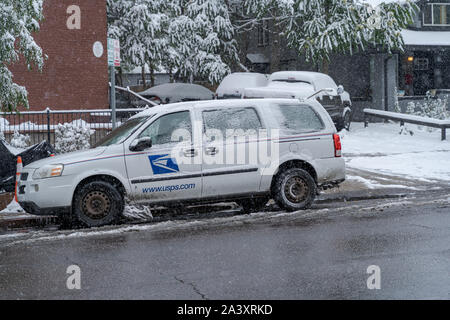 Denver, Colorado, USA- October 10, 2019: USPS delivery vehicle during Denver's first snow storm of the season. - Stock Photo