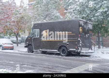 Denver, Colorado, USA- October 10, 2019: UPS delivery truck during Denver's first snow storm of the season. - Stock Photo