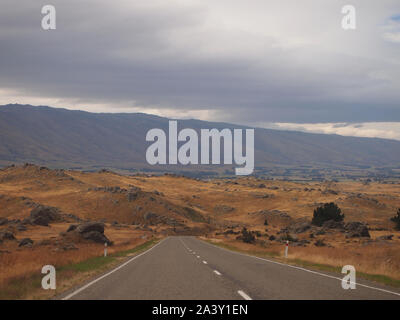 Rural roads near Dunedin in New Zealand South Island - Stock Photo