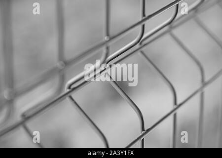 new grid fence close up, bw photo. - Stock Photo