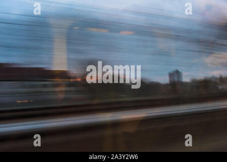 A Berlin skyscraper passing by in long-term exposure - Stock Photo