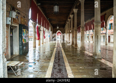 The famous fish market near the Rialto Bridge in Venice - Italy, when it is empty and clean at the end of a working day.