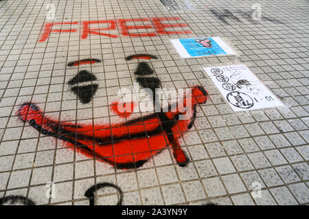 Hong Kong October 10, 2019 Art inspired by pro-democracy protesters found at many Lennon Walls around the city. - Stock Photo