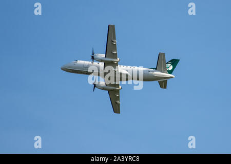 Air Chathams, Saab 304A, Flying over Auckland City, New Zealand - Stock Photo