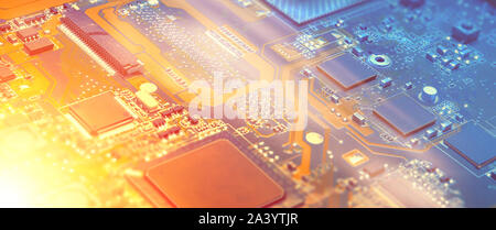 Closeup on electronic motherboard card in hardware repair shop. Blurred panoramic image with details of the circuitry and close-up on electronics. Fil - Stock Photo